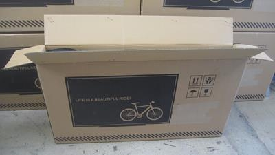 1. Set Ebike box upright, remove strapping, cut open along top edge, exposing the bike, being careful of the sharp staples.