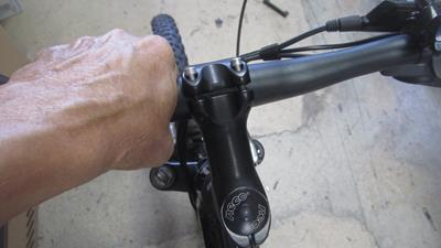 14. Adjust handlebars to a comfortable position, and tighten allen heads snugly with a No. 4 allenhead wrench. Tighten in a X pattern.