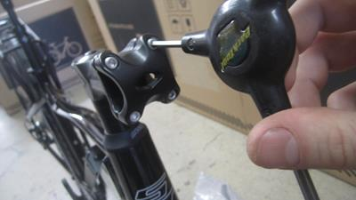 9. Remove four handlebar mount allenheads with No. 4 allen wrench